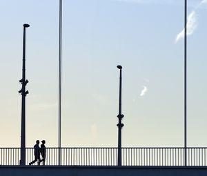 Preview wallpaper silhouettes, bridge, minimalism, walk