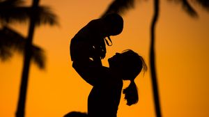 Preview wallpaper silhouettes, mother, child, sunset