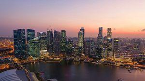 Preview wallpaper singapore, sunset, river, buildings, skyscrapers