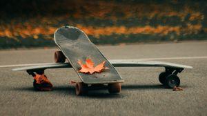 Preview wallpaper skate, skateboard, asphalt, leaves, autumn