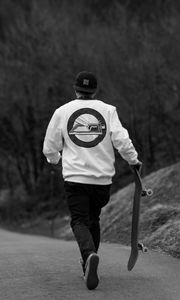 Preview wallpaper skater, skate, skateboard, road, black and white