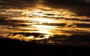 Preview wallpaper sky, clouds, sun, light, sunset, dark