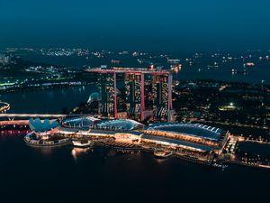 Preview wallpaper skyscraper, buildings, architecture, night, lights, sea