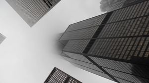 Preview wallpaper skyscrapers, fog, black and white