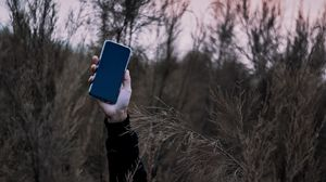Preview wallpaper smartphone, hand, grass, phone