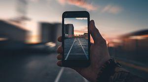 Preview wallpaper smartphone, hand, photo, blur