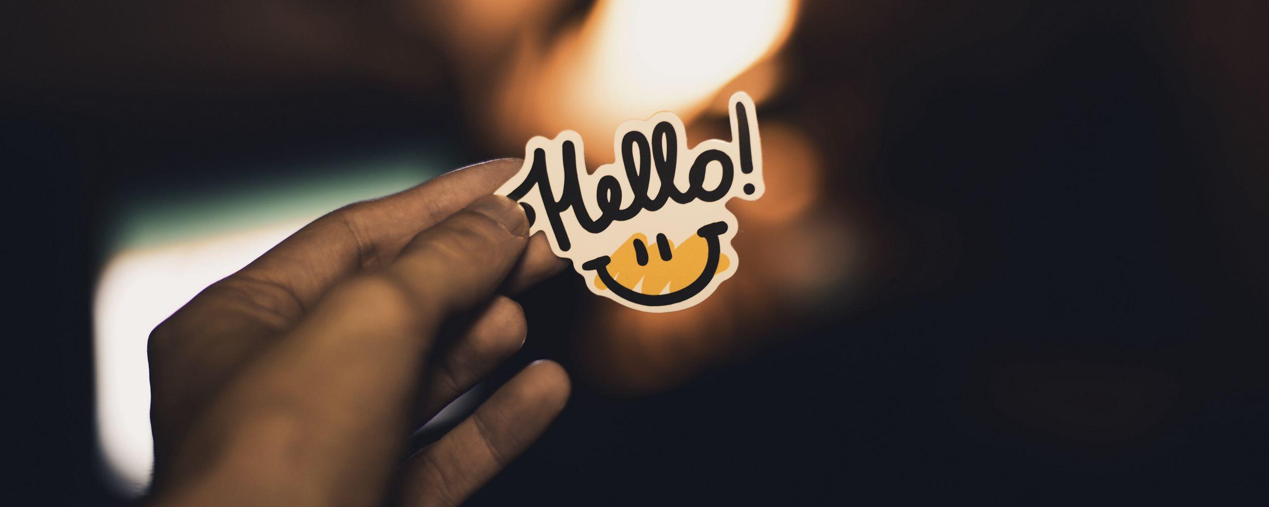 2560x1024 Wallpaper smile, inscription, hand, hello