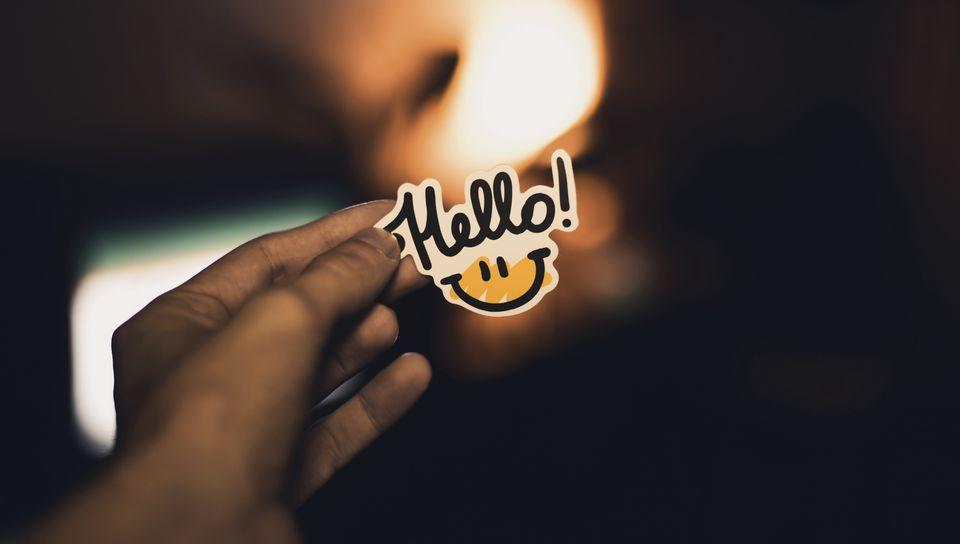 960x544 Wallpaper smile, inscription, hand, hello
