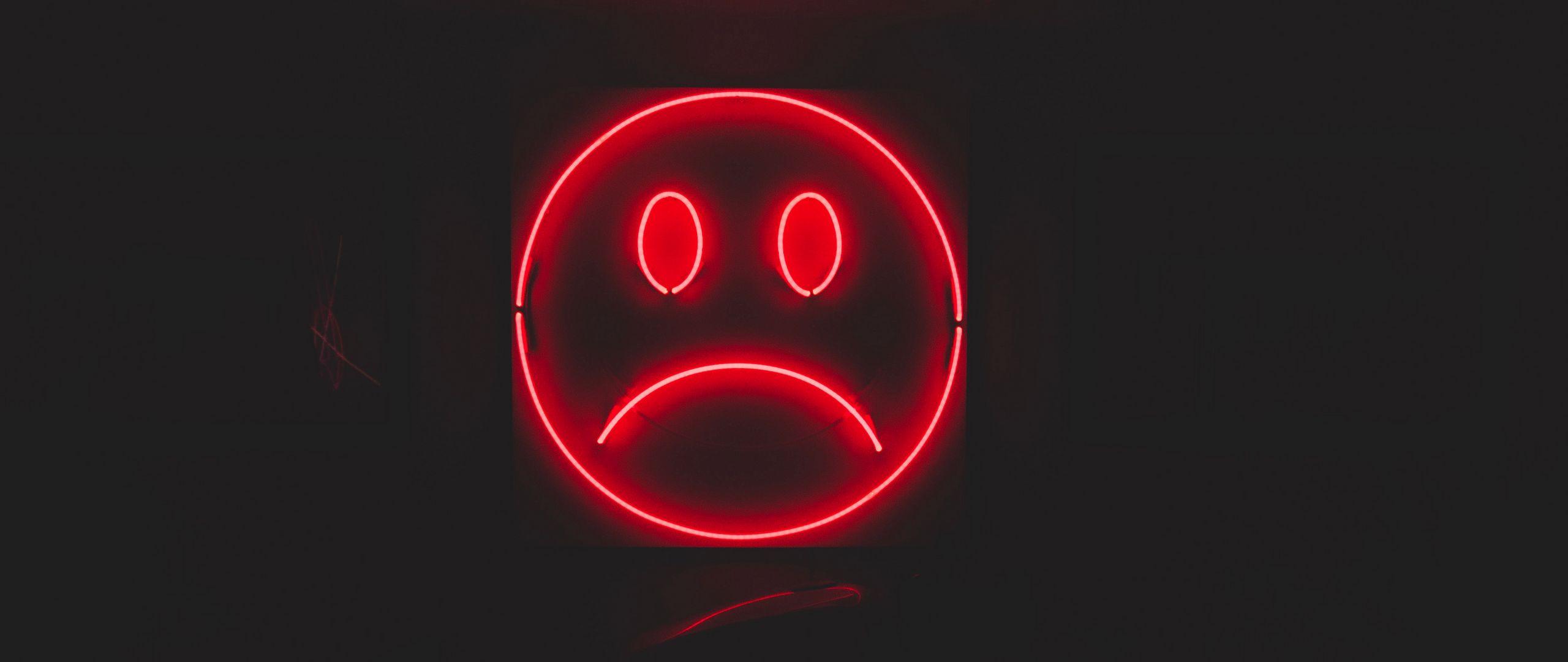 2560x1080 Wallpaper smile, smiley, sad, neon, red, dark