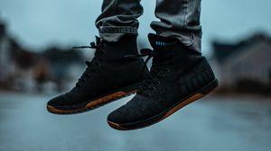Preview wallpaper sneakers, legs, jeans, asphalt