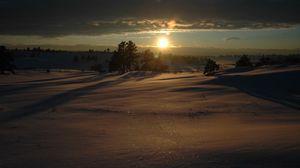 Preview wallpaper snow, winter, decline, evening, veil, carpet, snowdrifts, shine, beams