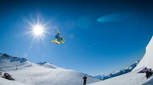 Preview wallpaper snowboarding, snowboarder, mountain, snow, slope