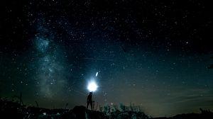 Preview wallpaper starry sky, man, light, glitter