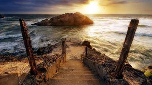 Preview wallpaper steps, ladder, descent, stakes, sea, waves, foam, rock, sun, light, cloudy, horizon
