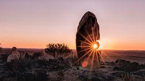Preview wallpaper stone, rock, sun, sunlight, sunset