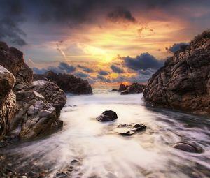Preview wallpaper stones, rocks, stream, water, sea, sky, clouds, orange, gleam