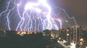 Preview wallpaper storm, night, buildings, sky, overcast