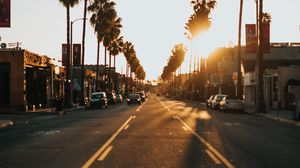 Preview wallpaper street, city, sunset, palm trees, cars