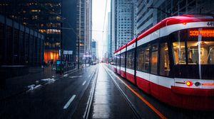 Preview wallpaper street, city, tram, buildings, rain