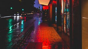 Preview wallpaper street, night, city lights, buildings, tile, road, stockholm, sweden