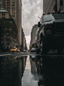 Preview wallpaper street, puddle, reflection, cars, buildings, asphalt