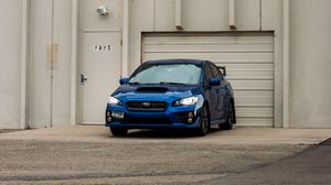 Preview wallpaper subaru, car, blue, parking, front view