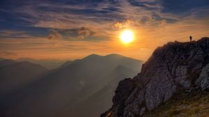 Preview wallpaper sun, light, rock, person, clouds, sky, height, climber, conquest