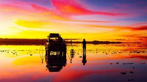 Preview wallpaper sunrise, photographer, car, horizon