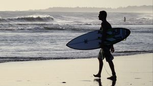 Preview wallpaper surfer, bali, beach, surfing