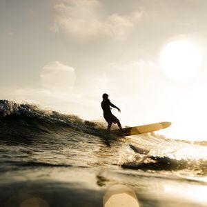 Preview wallpaper surfer, surfing, waves, sunset, glare, bokeh