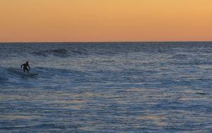 Preview wallpaper surfer, surfing, waves, ocean, sunset, dusk
