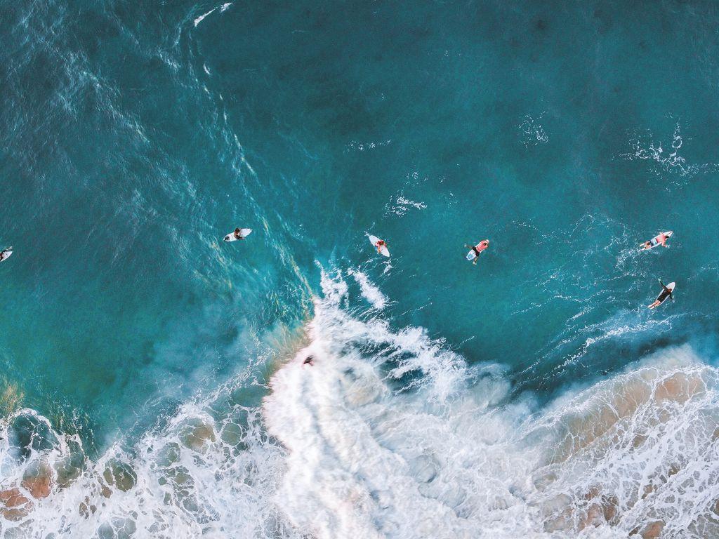 1024x768 Wallpaper surfing, ocean, rocks, aerial view