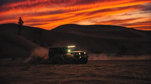 Preview wallpaper suv, car, headlight, desert, sunset