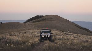 Preview wallpaper suv, mountain, car, grass, off-road