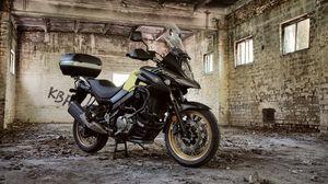 Preview wallpaper suzuki, motorcycle, bike, black, building, ruins
