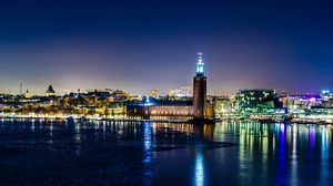 Preview wallpaper sweden, stockholm, winter, night, city hall, lights, reflection