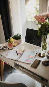 Preview wallpaper table, laptop, notepad, flowers, aesthetics
