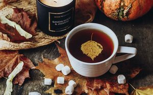 Preview wallpaper tea, cup, candle, autumn, leaves, comfort