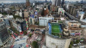Preview wallpaper tokyo, house, football, metropolis, field, people, roofs, crowds, japan, road, hdr