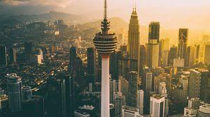 Preview wallpaper tower, skyscrapers, dawn, kuala lumpur, malaysia