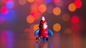 Preview wallpaper toy, parrot, bokeh, glare
