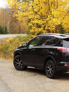 Preview wallpaper toyota, car, black, road, trees, autumn