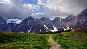 Preview wallpaper track, mountains, rocks, green, gray, grass, contrast, clouds, sky, white
