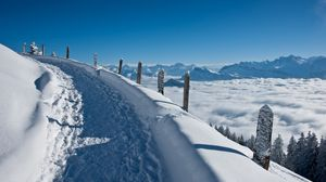 Preview wallpaper track, road, lifting, snow, winter, mountains, stakes