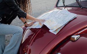 Preview wallpaper travel, map, guidebook, hood, car, hands