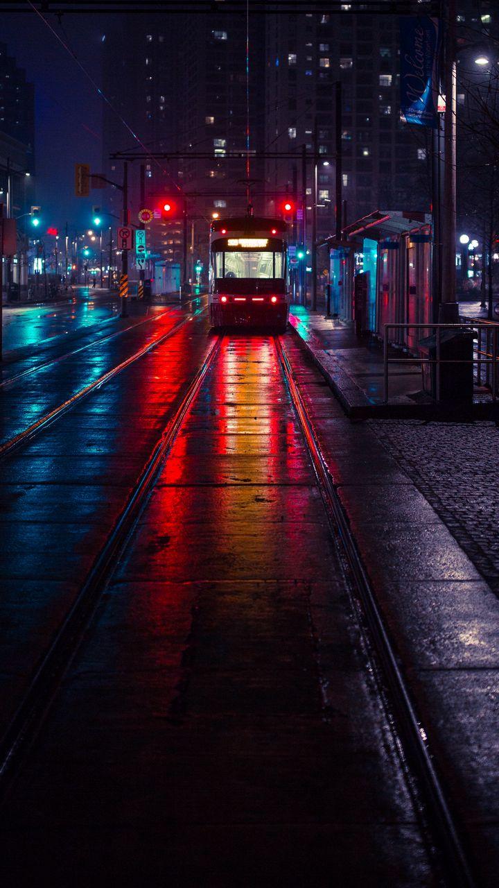 720x1280 Wallpaper trolley, stop, city, evening, lighting