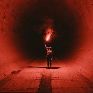 Preview wallpaper tunnel, man, gas mask, light, fire, red