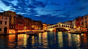 Preview wallpaper venice, canal, gondola, boat, night, lights, houses, clouds, italy