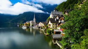 Preview wallpaper village, buildings, lake, mountain, clouds
