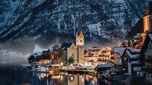 Preview wallpaper village, buildings, mountain, lake, reflection